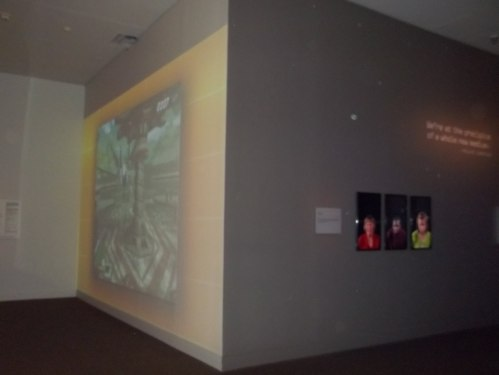 The left-facing wall ran a montage of various video games from all eras, while the three screens on the right-facing wall showed a changing montage people playing video games